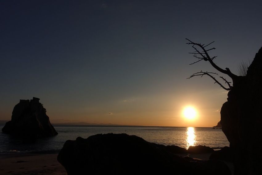 Sea Beauty In Nature Tranquility Silhouette Scenics Nature Sunset Sky Water Beach No People Horizon Over Water Outdoors