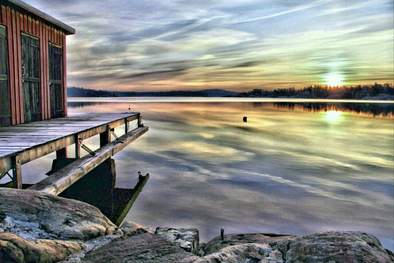 water, lake, sunset, tranquil scene, tranquility, sky, nature, scenics, cloud - sky, outdoors, beauty in nature, reflection, no people, architecture, built structure, winter, day, cold temperature, tree