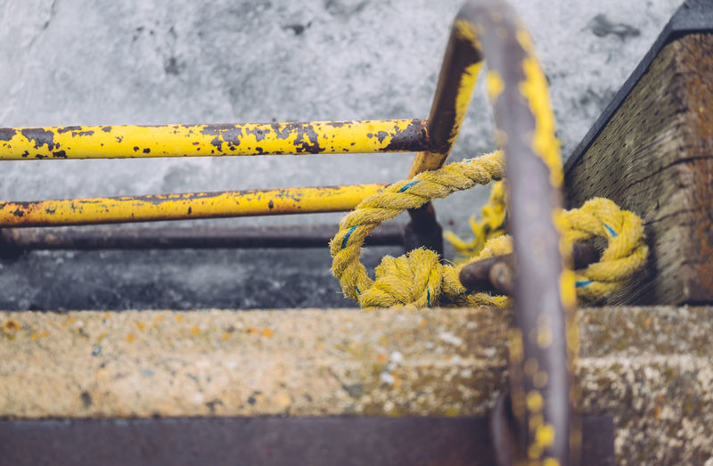 Close-up of cropped yellow railings