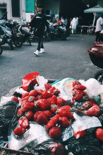 surface of Shanghai No. 1 Trash Strawberry Abandoned Red Red Color Color Surface PhonePhotography Phone Streetphotography Phone Photography Street Photography City Police Force Men Full Length