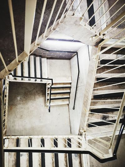 Directly below shot of spiral staircase in building