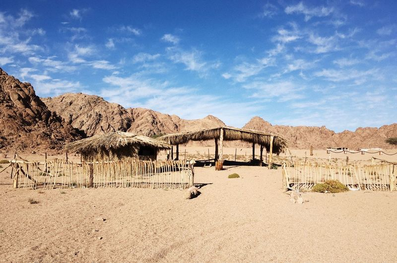 Thatched Roof On Desert Against Sky