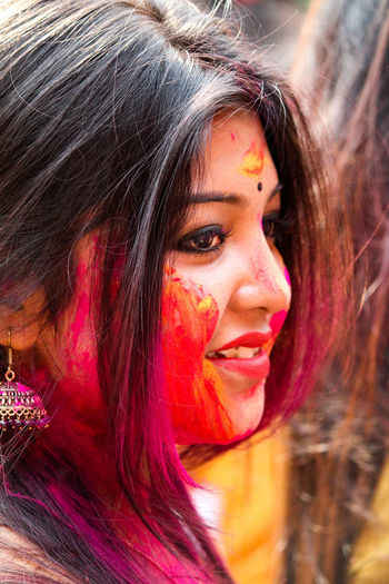 Close-up of woman with face paint during holi
