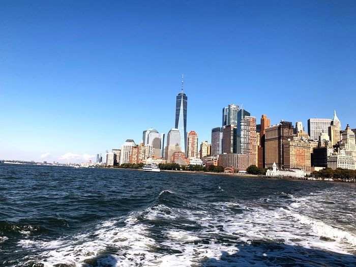 Far away city New York Sky Architecture Built Structure Building Exterior Water Clear Sky City Building Tourism Office Building Exterior Tower Sea Blue Tall - High Travel Nature