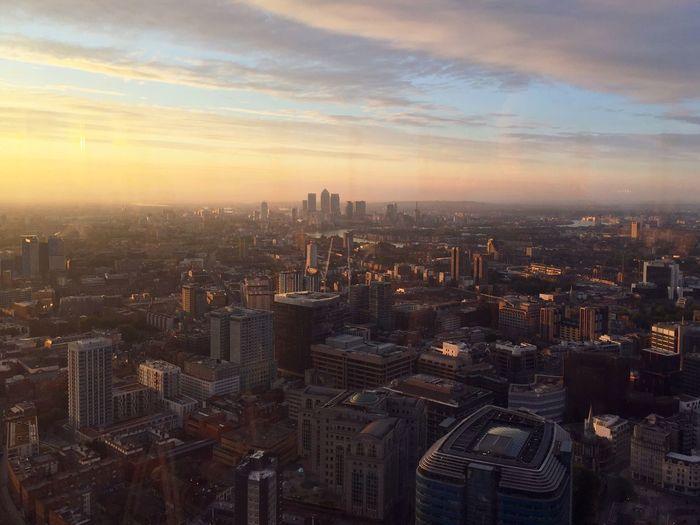Cityscape Against Cloudy Sky At Sunrise