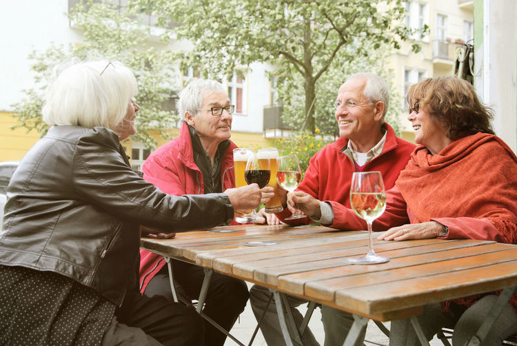 Four old Friends enjoying themselves in Berlin in early autumn, when the streetlife in Berlin is still very much alive 4 People Adult Autumn Berlin Bonding Casual Clothing Cheerful Enjoyment Food And Drink Friendship Fun Leisure Activity Lifestyles People Retirement Senior Adult Senior Men Senior Women Seniors Sitting Smiling Table Terrace Togetherness Women
