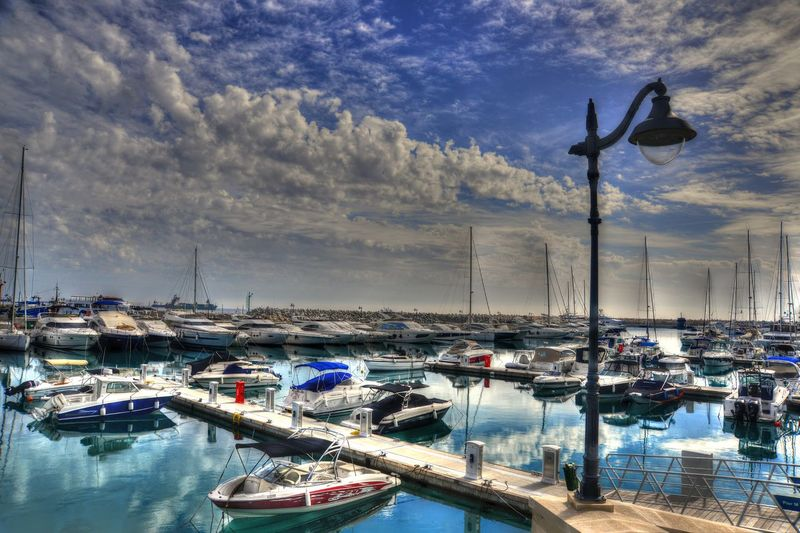 Architecture Beauty In Nature Boat City Cloud - Sky Day Harbor Marina Mast Mode Of Transport Moored Nature Nautical Vessel No People Outdoors Sailboat Sea Sky Transportation Water Yacht