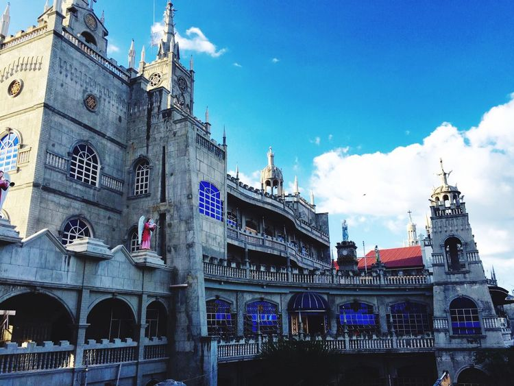 Simala Shrine, Cebu City, Philippines. Architecture Built Structure Building Exterior Sky Religion Spirituality Place Of Worship Low Angle View Religion Church Cloud Spire  Cloud - Sky Famous Place Travel Destinations Tourism Arch Blue Outdoors Day