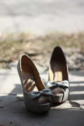 Close-up of stilettos on footpath