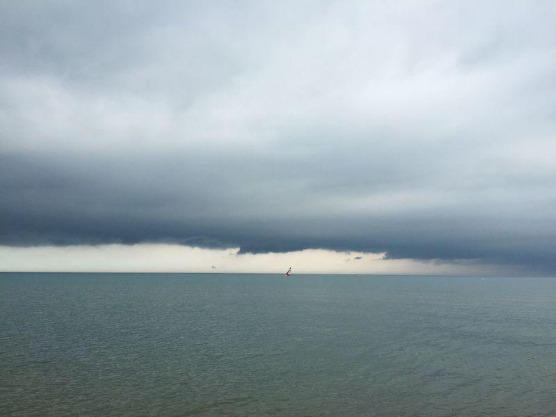 Sailboat sailing in lake with dark, storm clouds surrounding it. Sailboat Sailing Sail Lake Lake Michigan Water Dark Clouds Dark Storm Storm Clouds Bad Weather