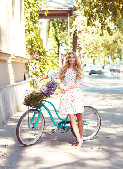 Full length portrait of woman riding bicycle