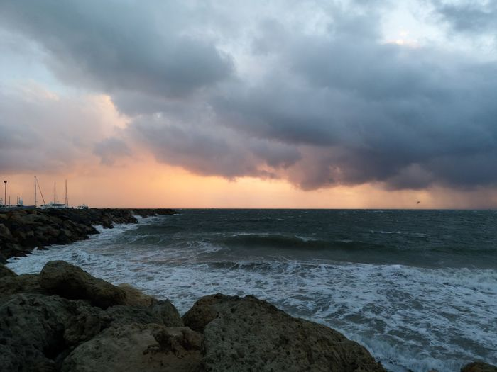 Indian Ocean. Winter evening. Water Wave Low Tide Sea Storm Cloud Sunset Beach Beauty Thunderstorm Multi Colored