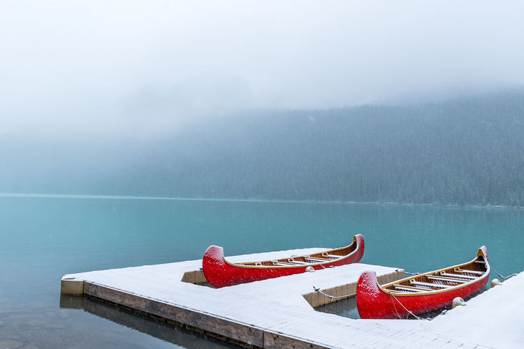Boats Moored On Lake During Winter