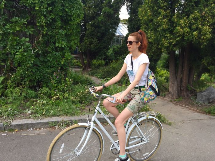 Riding bicycle Bicycle Cycling Tree One Person Young Adult Transportation Outdoors Mode Of Transport Smiling Young Women Real People Casual Clothing Day Lifestyles Nature Women Happiness Only Women Adult Beauty In Nature Millennial Girl Redhead Outdoor Life Activity