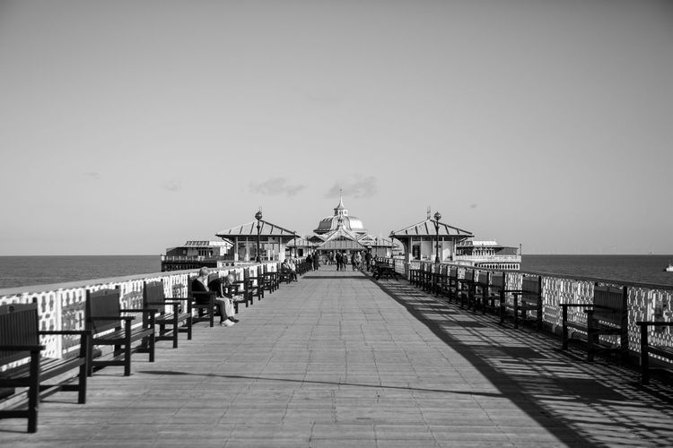 Llandudno pier north wales Water Sky Sea The Way Forward Horizon Horizon Over Water Direction Pier Architecture Built Structure Nature Clear Sky Beach Land Footpath Diminishing Perspective Day No People Copy Space Outdoors Long Llandudno Pier Wales UK
