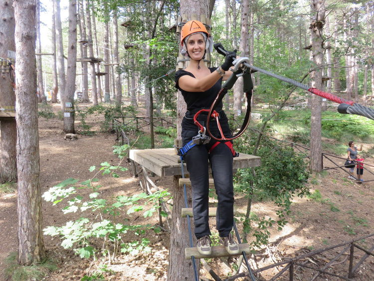 Casual Clothing Climbing Climbing A Mountain Day Equipment Forest Full Length Growth Harness Helmet Leisure Activity Lifestyles Nature Outdoors Park Adventures Portrait Ropes Tranquility Tree Tree Trunk Vacations Woman WoodLand Feel The Journey