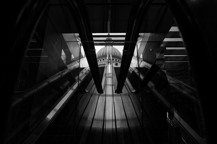 Monochrome Photography High Angle View Railing Indoors  Escalator Convenience Technology Modern Close-up Connection Architecture Steps The Way Forward Architectural Feature Long Narrow City Life No People