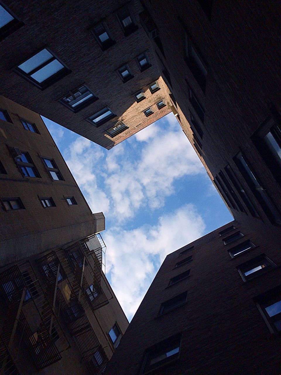 architecture, building exterior, built structure, low angle view, sky, window, no people, day, cloud - sky, outdoors, city