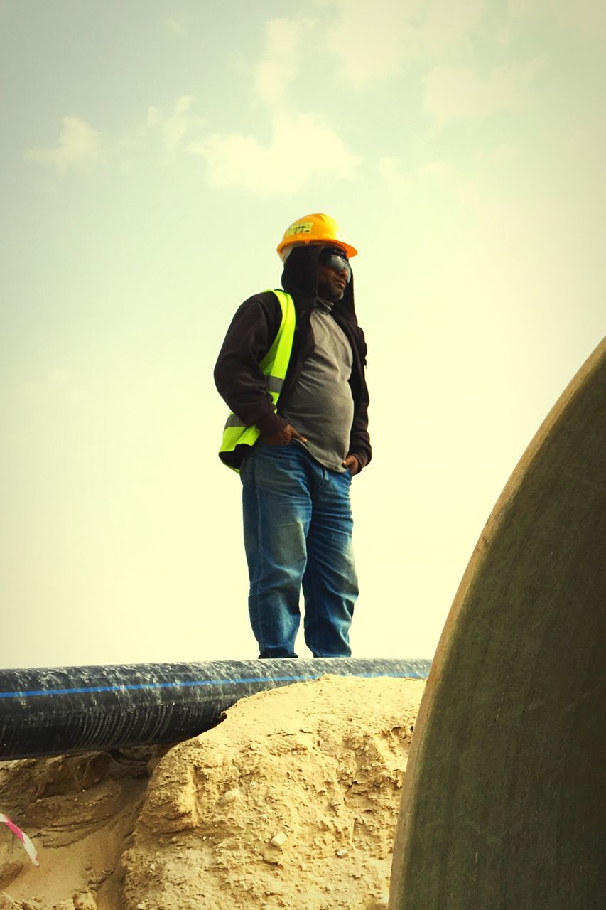 one person, real people, full length, sky, day, men, outdoors, lifestyles, protective workwear, nature, water, working, manual worker, people