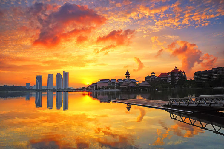 Beautiful sunrise view of Putrajaya with beautiful architecture building surrounding the lake Architecture Backgrounds Beauty In Nature Building Exterior Built Structure City Cloud - Sky Day Lake Malaysia Nature No People Orange Color Outdoors Putrajaya Reflection Scenics Sky Sunrise Sunset Travel Destinations Wallpaper Water Waterfront