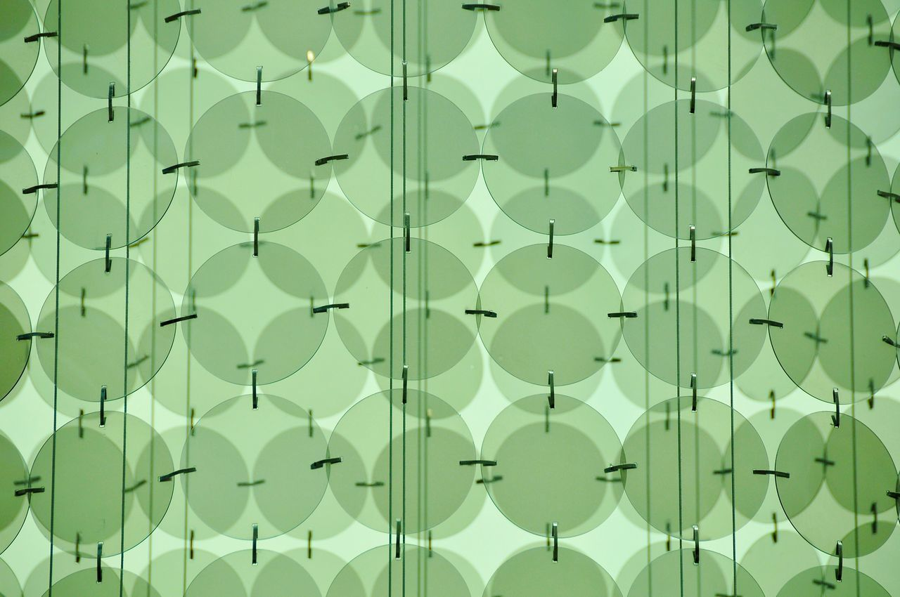 Close-up of green circle shape glass background