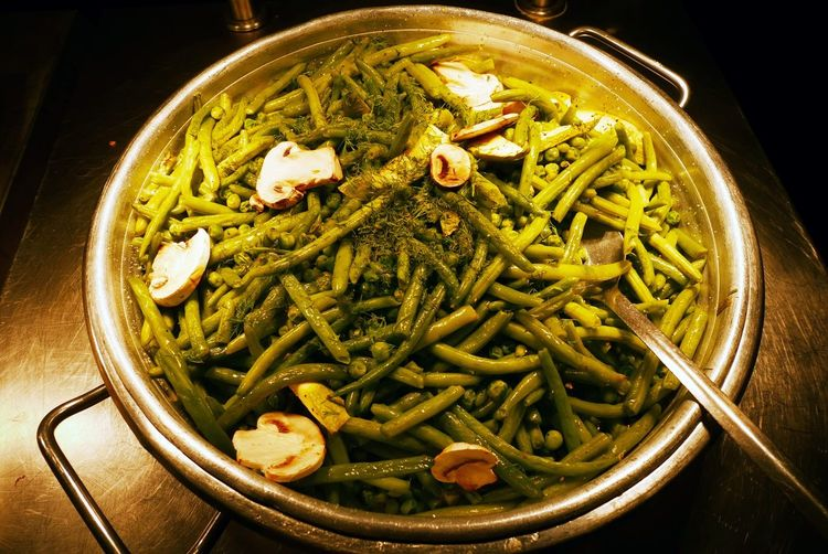 High Angle View Of Green Beans With Mushrooms Served On Table