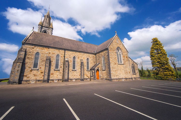Irelands churches Go Pro Go Pro Hero 5 Ireland Church Irish Architecture Built Structure Cloud - Sky Religion Belief Place Of Worship Building Sky Building Exterior Spirituality Day Nature History The Past Road No People Travel Destinations Dividing Line