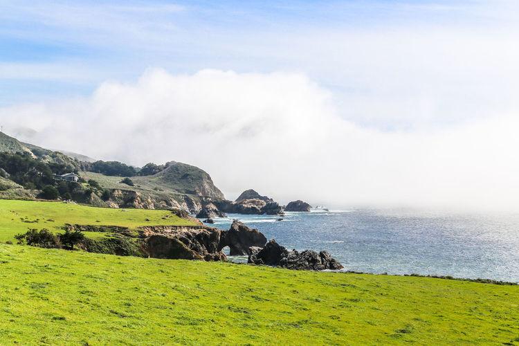 big sur California Coastline Grass Green Land Beach Blue Clouds Clouds And Sky Coast No People Non-urban Scene Ocean Scenic Landscapes Scenic Nature Scenics Scenics - Nature Sea