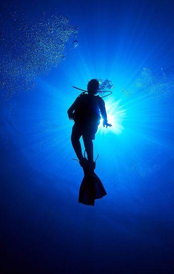 Silhouette scuba diver