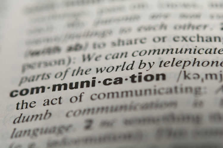 Close-up of communication text in dictionary