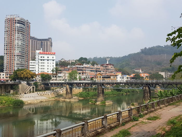 community of town City Water Tree Cityscape Sky Architecture Building Exterior Bridge - Man Made Structure Town River Arch Bridge Office Building Cable-stayed Bridge Chain Bridge Residential Structure
