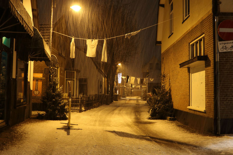 photo made in the center of Bennekom during a snow storm in the early morning Dickens Festival Alley Cristmas House Kerst Night No People Outdoors Street Street Light Street Photography Town Shades Of Winter