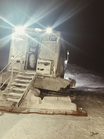 Ride to dinner Nightshot Transportation Vehicle Mountain Life Snow Cat Illuminated Light Beam Sunlight Low Angle View No People Indoors  Metal Industry Shades Of Winter