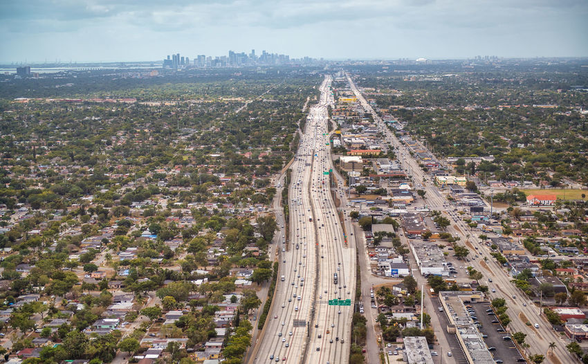 Aerial view of road amidst buildings in city