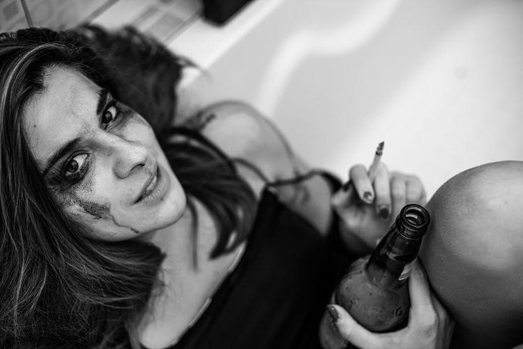 Portrait of women smoking cigarette in a tub