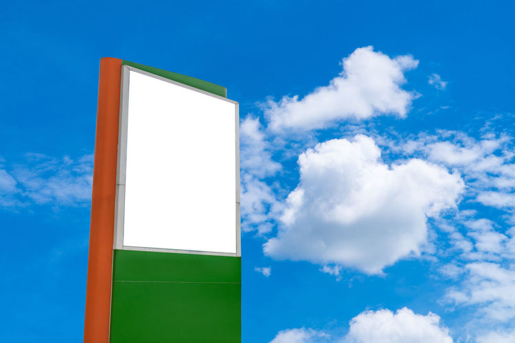Low angle view of empty billboard sign against cloudy sky