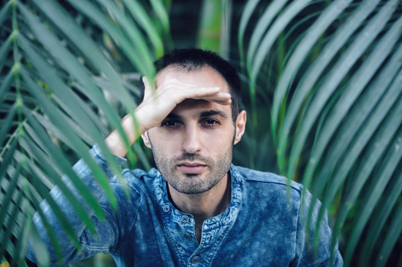 Bearded man among the palm leaves Palm Tree Plants Tropical Plants Tropical Climate Tropical Portrait Young Men One Person Looking At Camera Young Adult Front View Green Color Real People Casual Clothing Leisure Activity Nature Beautiful People Men Handsome Lifestyles Confidence  Outdoors