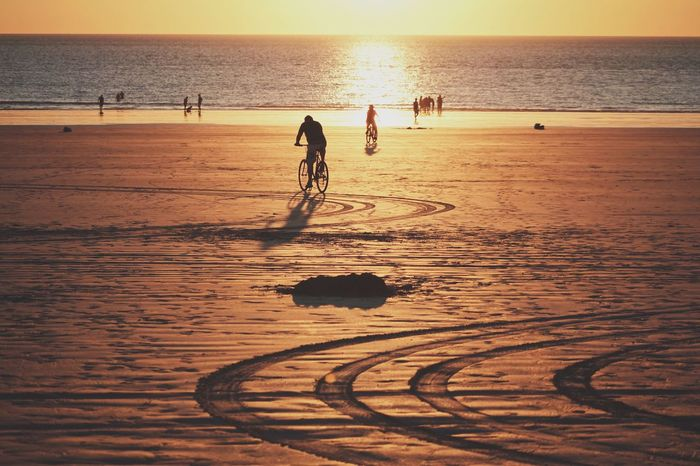 Rough edges and perfect curves. Beach Sunset Sport Sea Sand Playing Leisure Activity Real People Water Nature Skill  Lifestyles Men Silhouette Horizon Over Water Scenics Outdoors Beauty In Nature Day Bicycle Cycling The Week On EyeEm The Week On EyeEm
