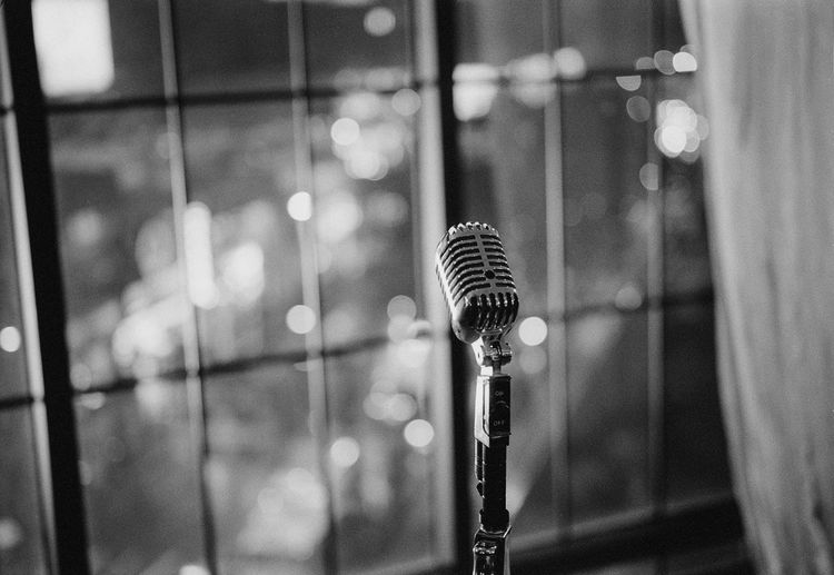 Close-up of microphone against window