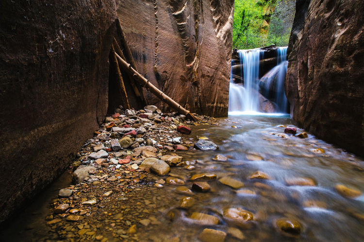 Water Rock Solid Motion Rock - Object Beauty In Nature Scenics - Nature Waterfall Flowing Water Nature Long Exposure Flowing Forest River Blurred Motion No People Outdoors Land Environment Day
