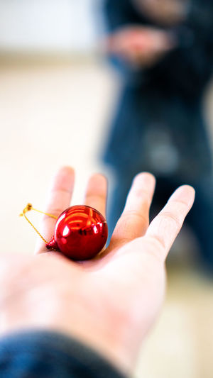 Reflection Abstract Adult Art Ball Christmas Decoration Christmas Ornament Circle Close-up Fingers Focus On Foreground Hand Holding Human Body Part Human Finger Human Hand Indoors  Jeans Knee Down Mirror Nail One Man Only One Person Redball Reflection