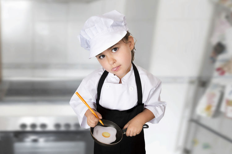 Young chef girl Chef Chef's Hat Chef's Whites Commercial Kitchen Food Food And Drink Indoors  Looking At Camera One Person People Portrait Real People Restaurant School Uniform Standing Uniform