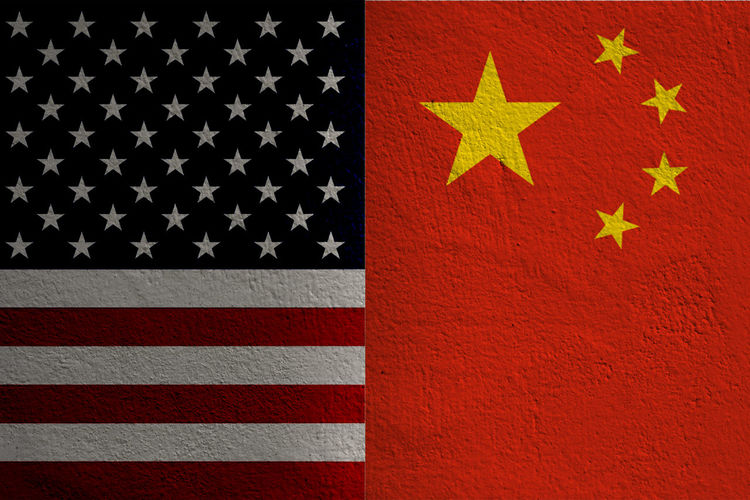 Closeup separate of USA flag and China flag .It is symbol of tariff trade war crisis between United States of America and China which the biggest economic country in the world. America Background Banner Barrier Battle Business China Commerce Competition Conflict Crisis Defeat Design Dispute Dollar Economy Emblem  Exchange Export Fight Financial Flag Global Government Import Industry Investment Loss Money Negotiations Patriotism Policy Politics Protectionism RISK Rmb Sign Surplus Symbol Tariff Tax Trade United Us USA Versus Vs War World YUAN