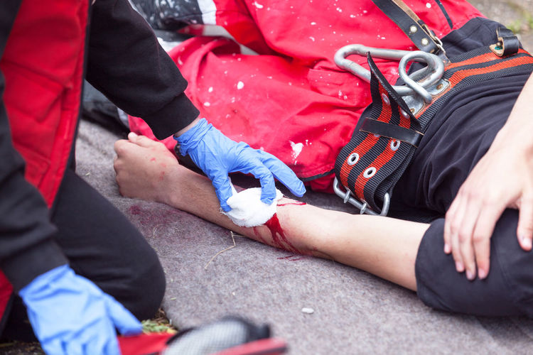 Close-Up Of Paramedics Examining Man
