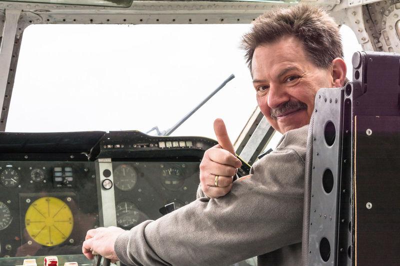 Portrait of man sitting in air vehicle cockpit