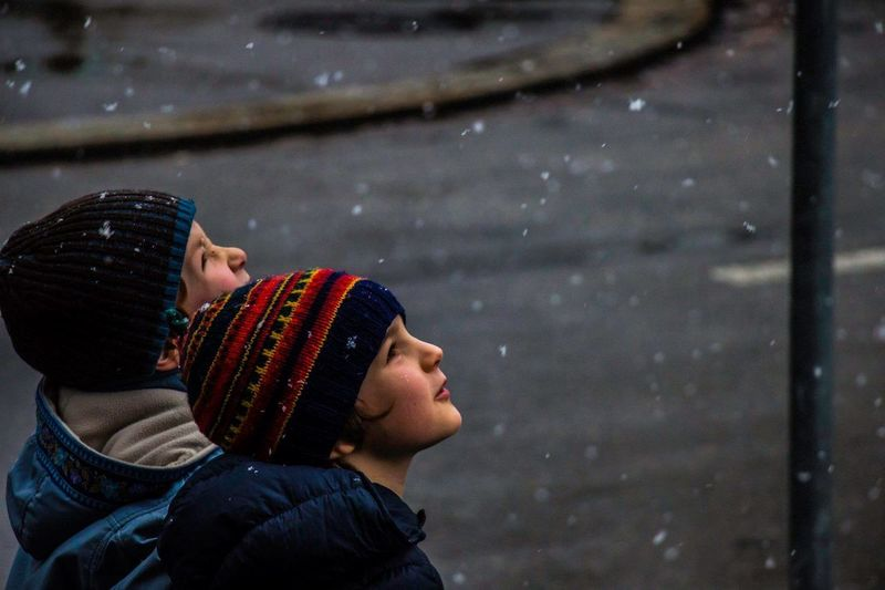 Boys looking at snow