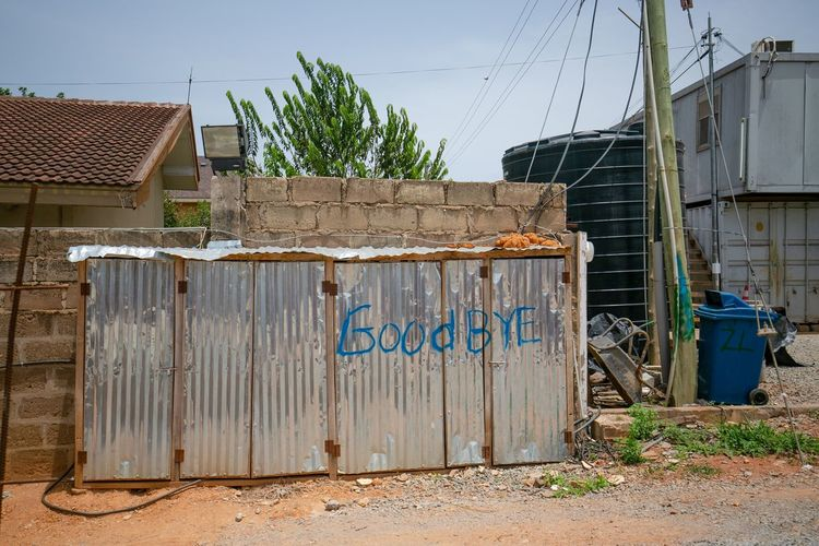 Electrical panel on a construction site. Goodbye is apt if u find itself going through there Dorofoto Onefotos Eyeemghana Building Exterior Sky Built Structure Architecture Nature No People Day Plant Clear Sky Building Container Outdoors Fence House Boundary City