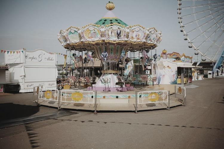 Carousel Against Sky In Amusement Park