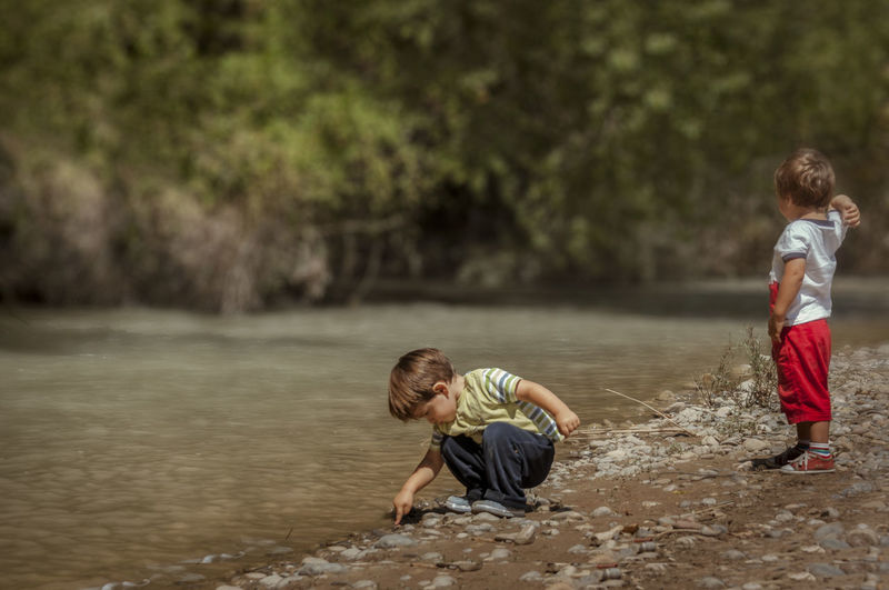 Kids exploring the world Alpha Kids Playing River Sony Stone Childhood Water Boys Real People Two People Day Nature Exploring Summertime