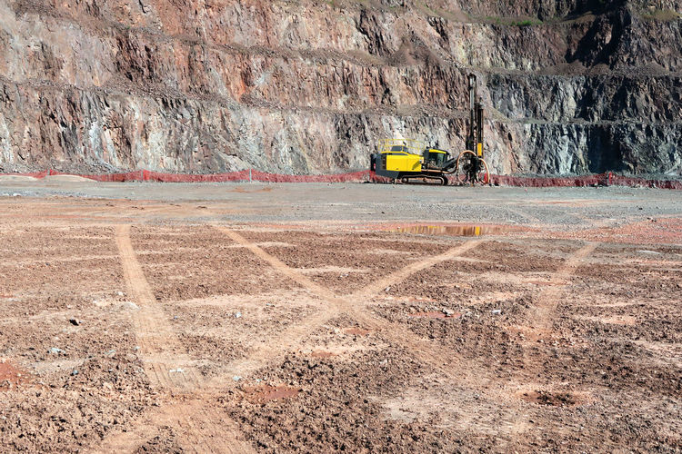 drill machine in a quarry mine. Day Drill Driller Drilling Mine Mining Mining Heritage Mining Industry Nature No People Open Pit Mine Open Pit Mining Outdoors Quarry Road Skidmarks Sunny Surface Mine Surface Mining The Way Forward